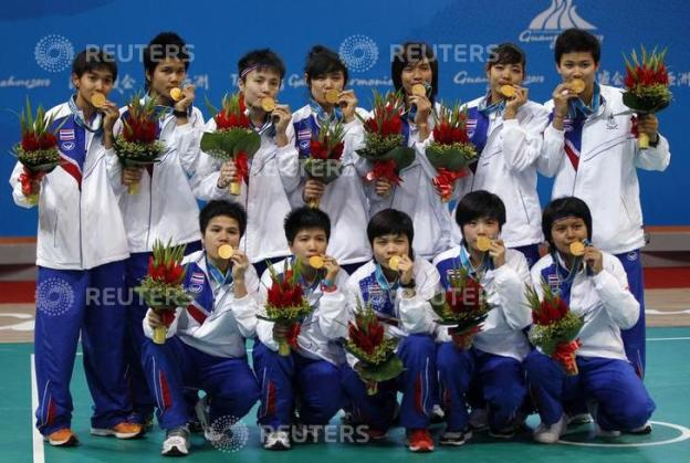 Members of Thailand's women's sepak takraw team pose with their gold medals at the 16th Asian Games in Guangzhou