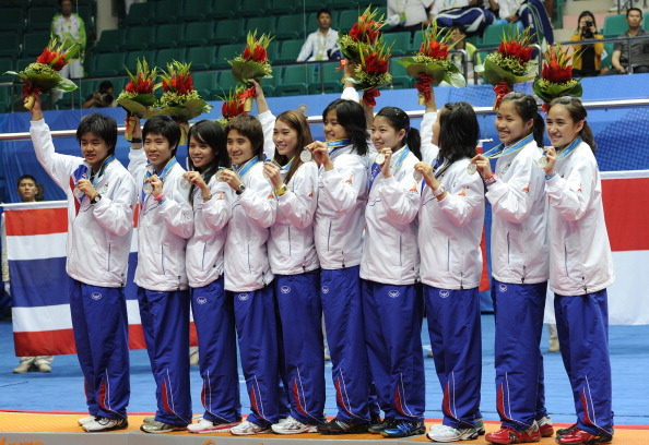 The Thai team pose on the podium after w Credit: LIU JIN / Staff