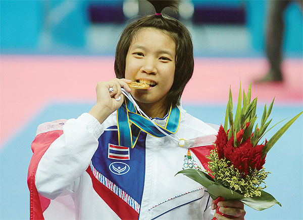 Sarita Phongsri celebrates with her gold medal after winning the women's 53kg