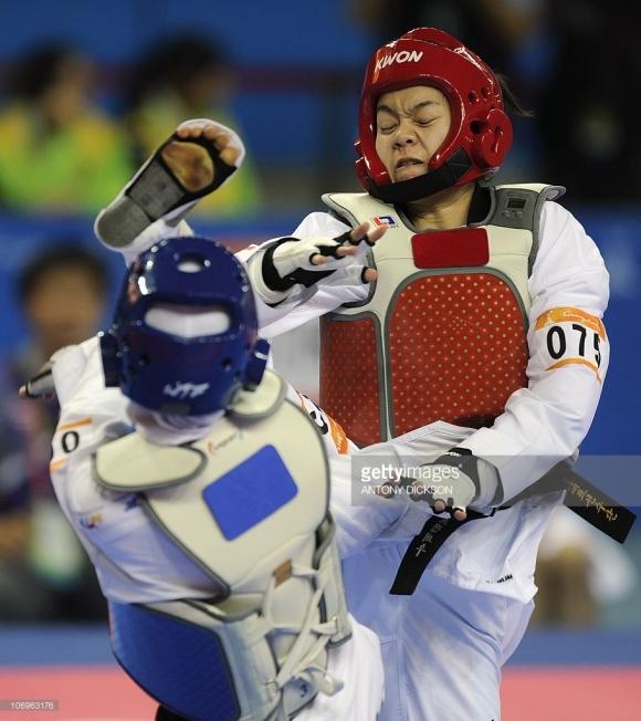 Dhunyanun Premwhaew of Thailand (R) fights with Raheleh Asemani of Iran