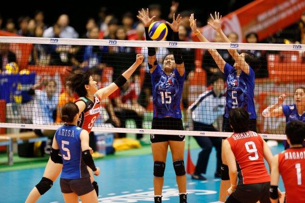 K.Malika #15 and T.Pleumjit #5 of Thailand block the ball